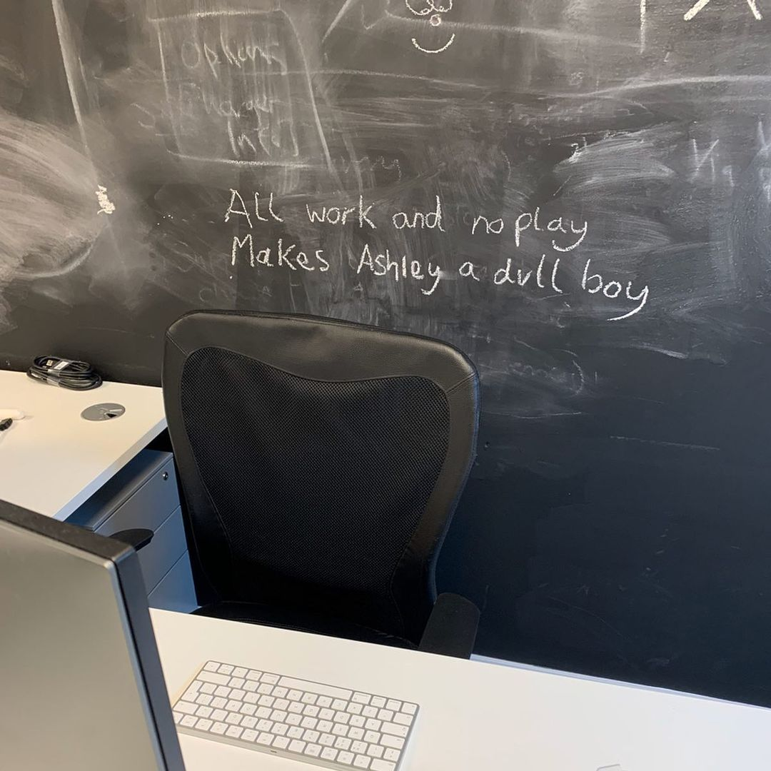 "The words ""all work and no play makes Ashley a dull boy"" on a blackboard"